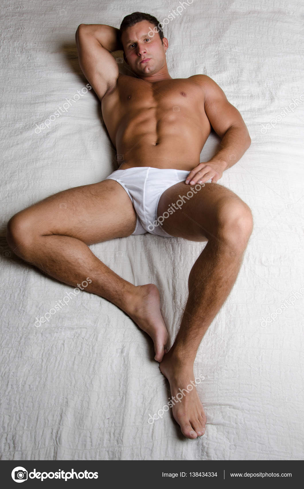 Sexy naked guy in bed