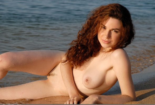 Curly haired beach nude