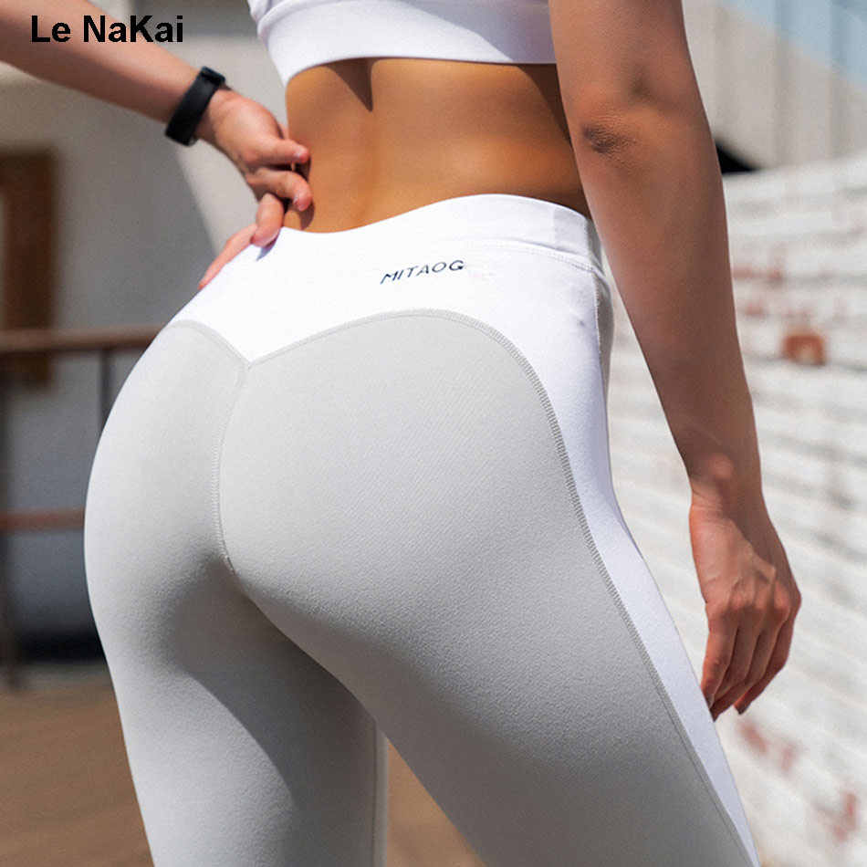 Huge white booty in colorful tight pants