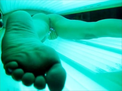 Masterbating in tanning bed
